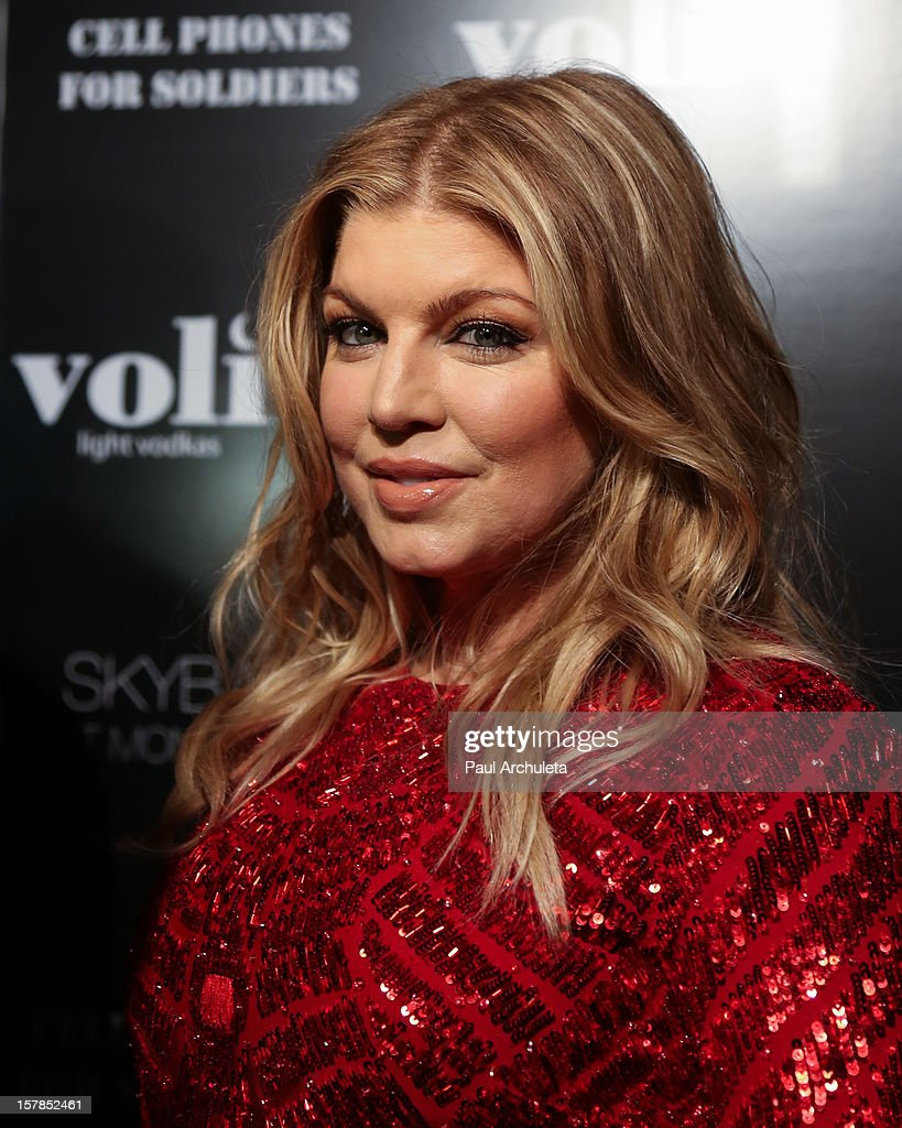 Recording Artist Fergie attends the Cell Phones For Soldiers charity event sponsored by Voli Light Vodka at Sky Bar in the Mondrian Hotel on December 6, 2012 in West Hollywood, California.