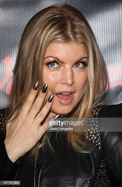 Recording artist Fergie attends the opening night of Walgreens' new flagship store in Los Angeles on November 30 2012 in Hollywood California