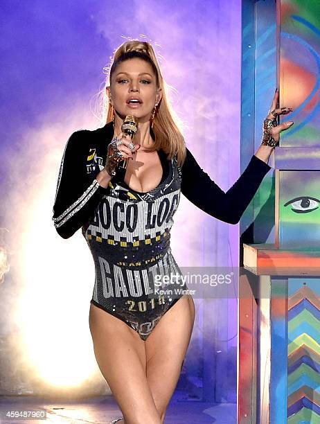 Recording artist Fergie performs onstage at the 2014 American Music Awards at Nokia Theatre LA Live on November 23 2014 in Los Angeles California