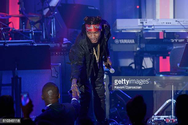 Recording artist Fetty Wap shakes hands with recording artist/actor Jamie Foxx during the 2016 PreGRAMMY Gala and Salute to Industry Icons honoring...