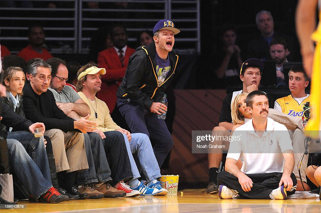 Recording artist Flea of the Red Hot Chili Peppers yells during a game between the Utah Jazz and the Los Angeles Lakers at Staples Center on December 9, 2012 in Los Angeles, California.