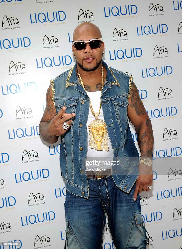 Recording artist Flo Rida arrives at the Liquid Pool Lounge at the Aria Resort & Casino at CityCenter on May 27, 2013 in Las Vegas, Nevada.