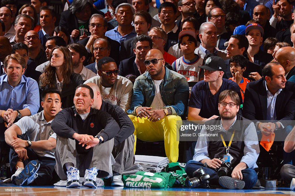 Recording artist Flo Rida, center, looks on as the Boston Celtics play the New York Knicks in Game Five of the Eastern Conference Quarterfinals during the 2013 NBA Playoffs on May 1, 2013 at Madison Square Garden in New York City