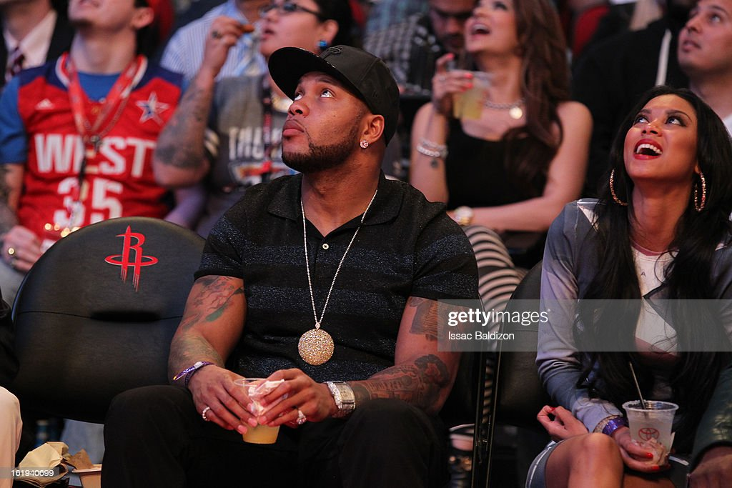 Recording Artist Flo Rida looks up at the big screen as he watches the game from courtside during 2013 NBA All-Star Game on February 17, 2013 at Toyota Center in Houston, Texas.