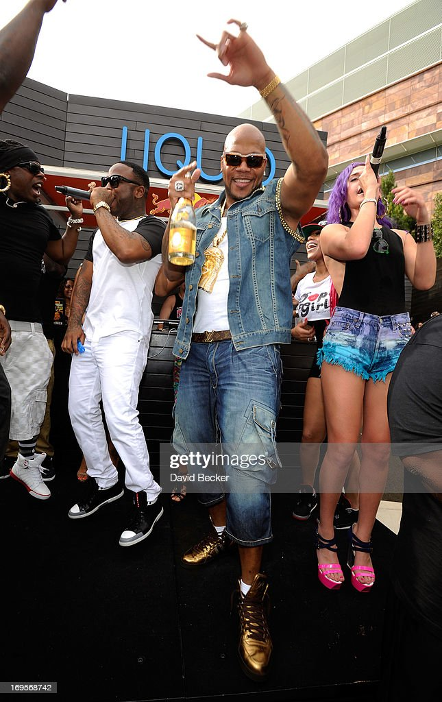 Recording artist <a gi-track='captionPersonalityLinkClicked' href=/galleries/search?phrase=Flo+Rida&family=editorial&specificpeople=4456012 ng-click='$event.stopPropagation()'>Flo Rida</a> (C) performs at the Liquid Pool Lounge at the Aria Resort & Casino at CityCenter on May 27, 2013 in Las Vegas, Nevada.