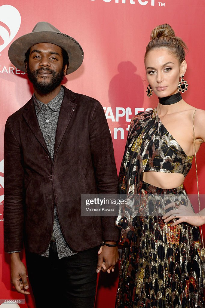 Recording artist Gary Clark Jr. (L) and model Nicole Trunfio attend the 2016 MusiCares Person of the Year honoring Lionel Richie at the Los Angeles Convention Center on February 13, 2016 in Los Angeles, California.