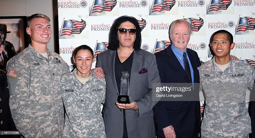 Recording artist <a gi-track='captionPersonalityLinkClicked' href=/galleries/search?phrase=Gene+Simmons&family=editorial&specificpeople=138593 ng-click='$event.stopPropagation()'>Gene Simmons</a> (3nd from L) and actor <a gi-track='captionPersonalityLinkClicked' href=/galleries/search?phrase=Jon+Voight&family=editorial&specificpeople=202872 ng-click='$event.stopPropagation()'>Jon Voight</a> (4th from L) attend <a gi-track='captionPersonalityLinkClicked' href=/galleries/search?phrase=Gene+Simmons&family=editorial&specificpeople=138593 ng-click='$event.stopPropagation()'>Gene Simmons</a> being honored with the Durning Patriotism Award at the Salute to Veterans event hosted by the California Disabled Veterans Business Alliance at Paramount Studios on November 7, 2013 in Hollywood, California.