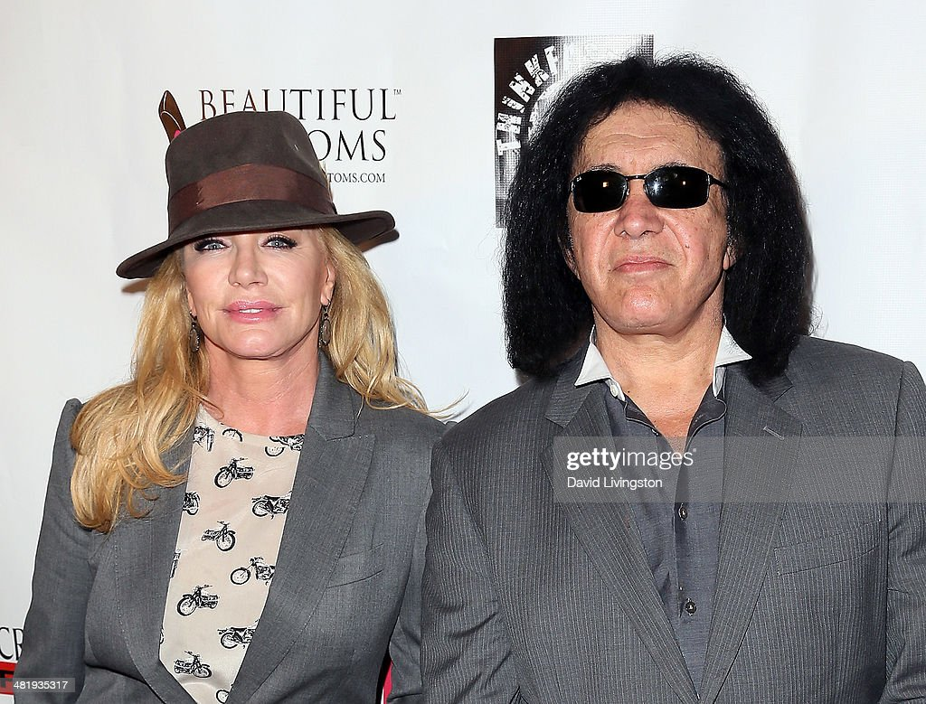 Recording artist Gene Simmons (R) and wife actress Shannon Tweed attend the premiere of Screen Media Films' '10 Rules for Sleeping Around' at the Egyptian Theatre on April 1, 2014 in Hollywood, California.