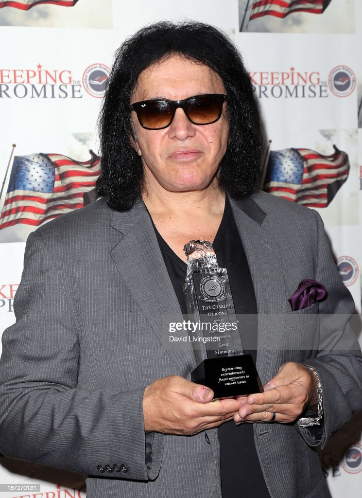 Recording artist <a gi-track='captionPersonalityLinkClicked' href=/galleries/search?phrase=Gene+Simmons&family=editorial&specificpeople=138593 ng-click='$event.stopPropagation()'>Gene Simmons</a> receives the Durning Patriotism Award at the Salute to Veterans event hosted by the California Disabled Veterans Business Alliance at Paramount Studios on November 7, 2013 in Hollywood, California.