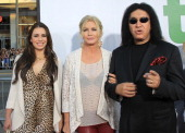 Recording artist Gene Simmons Sharon Tweed and their daughter attend the Premiere Of Universal Pictures' 'Ted' at Grauman's Chinese Theatre on June...