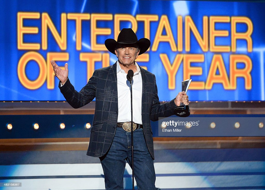 Recording artist <a gi-track='captionPersonalityLinkClicked' href=/galleries/search?phrase=George+Strait&family=editorial&specificpeople=234588 ng-click='$event.stopPropagation()'>George Strait</a> accepts the Entertainer of the Year award onstage during the 49th Annual Academy of Country Music Awards at the MGM Grand Garden Arena on April 6, 2014 in Las Vegas, Nevada.