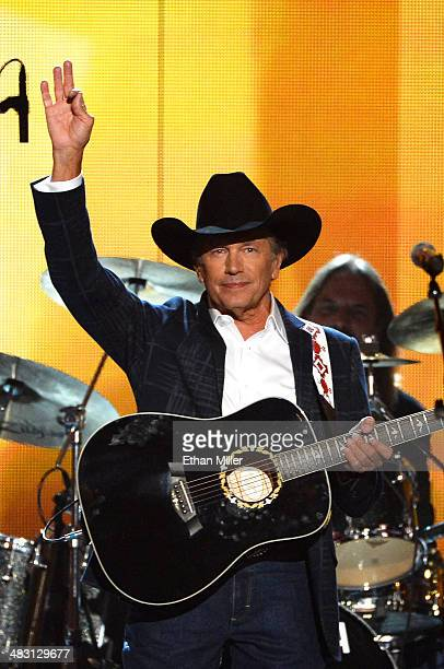 Recording artist George Strait performs onstage during the 49th Annual Academy of Country Music Awards at the MGM Grand Garden Arena on April 6 2014...