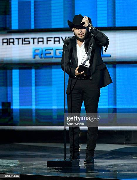 Recording artist Gerardo Ortiz accepts the award for Favorite Artist Regional Mexican onstage during the 2016 Latin American Music Awards at Dolby...