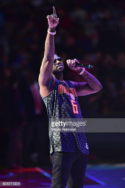 Recording artist Gucci Mane performs halftime at the New Orleans Pelicans vs Atlanta Hawks Game at Philips Arena on November 22 2016 in Atlanta...