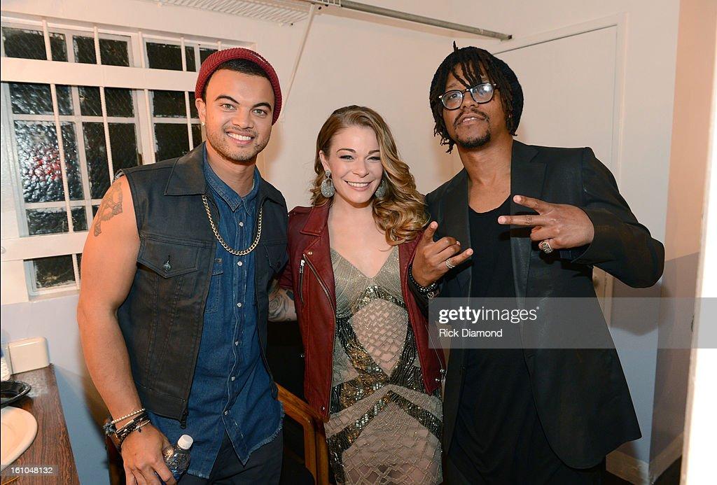 Recording artist Guy Sebastian, singer LeAnn Rimes and rapper Lupe Fiasco pose backstage at the GRAMMYs Dial Global Radio Remotes during The 55th Annual GRAMMY Awards at the STAPLES Center on February 8, 2013 in Los Angeles, California.