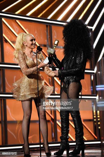Recording artist Gwen Stefani presents the Icon Award to honoree Cher onstage during the 2017 Billboard Music Awards at TMobile Arena on May 21 2017...