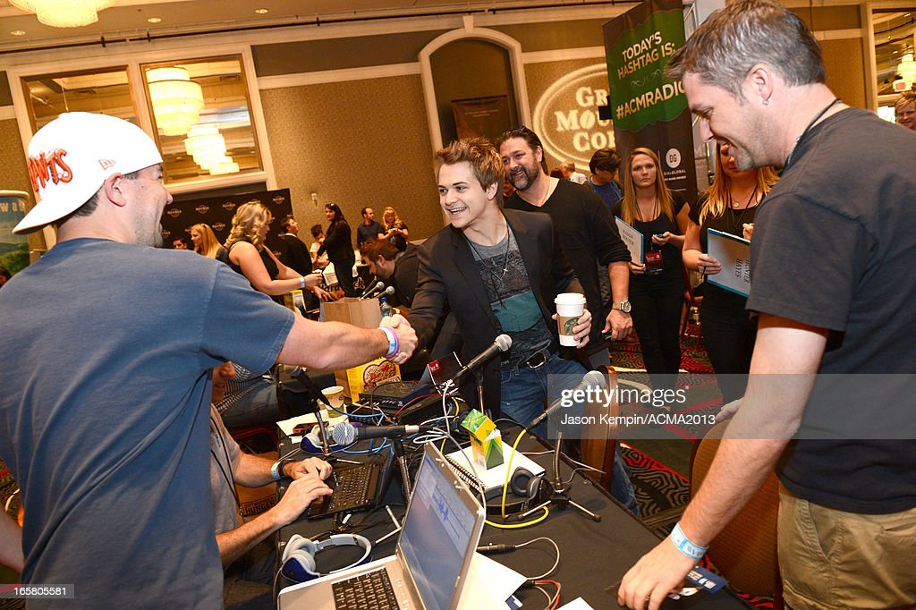Recording artist <a gi-track='captionPersonalityLinkClicked' href=/galleries/search?phrase=Hunter+Hayes&family=editorial&specificpeople=3290701 ng-click='$event.stopPropagation()'>Hunter Hayes</a> (center) attends the Dial Global Radio Remotes during The 48th Annual Academy of Country Music Awards at the MGM Grand on April 5, 2013 in Las Vegas, Nevada.