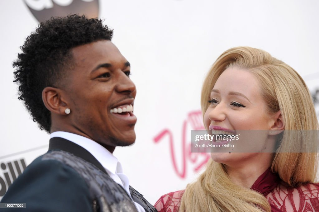 Recording artist Iggy Azalea (R) and NBA player Nick Young arrive at the 2014 Billboard Music Awards at the MGM Grand Garden Arena on May 18, 2014 in Las Vegas, Nevada.