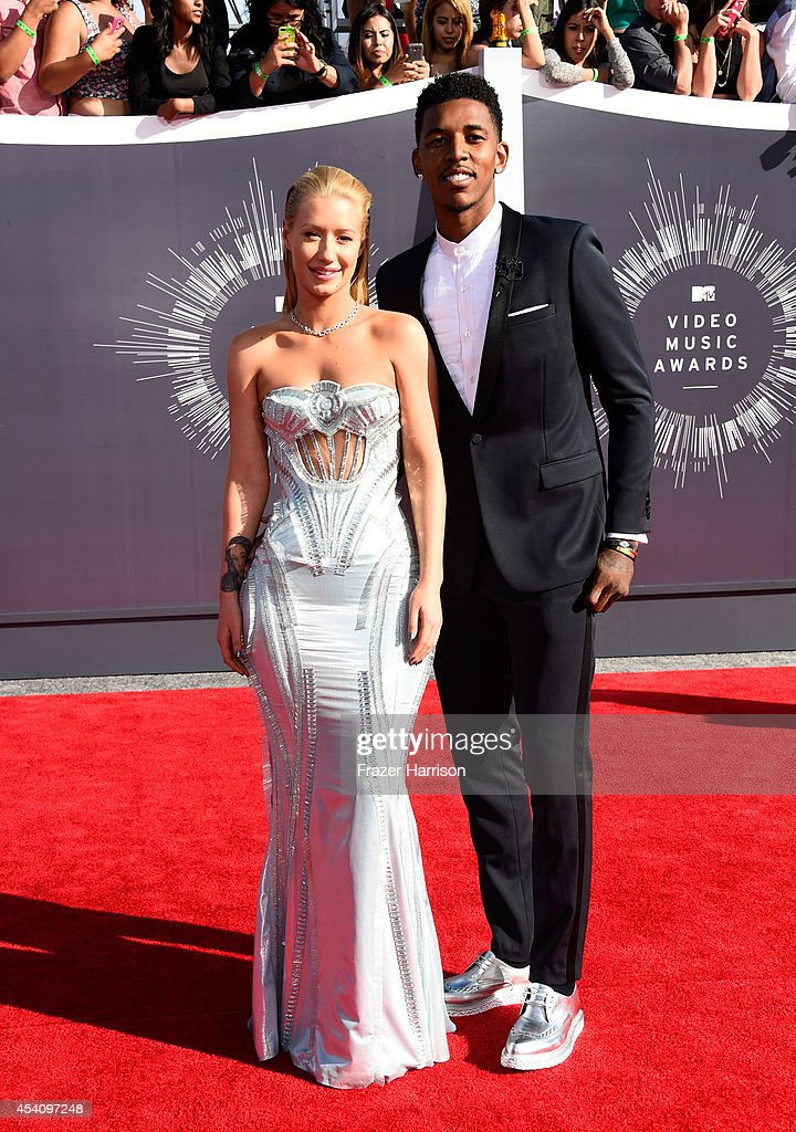 Recording artist Iggy Azalea (L) and professional athlete Nick Young attend the 2014 MTV Video Music Awards at The Forum on August 24, 2014 in Inglewood, California.