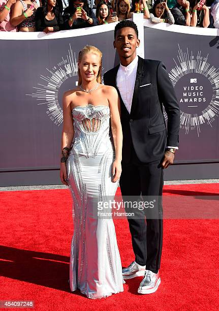 Recording artist Iggy Azalea and professional athlete Nick Young attend the 2014 MTV Video Music Awards at The Forum on August 24 2014 in Inglewood...