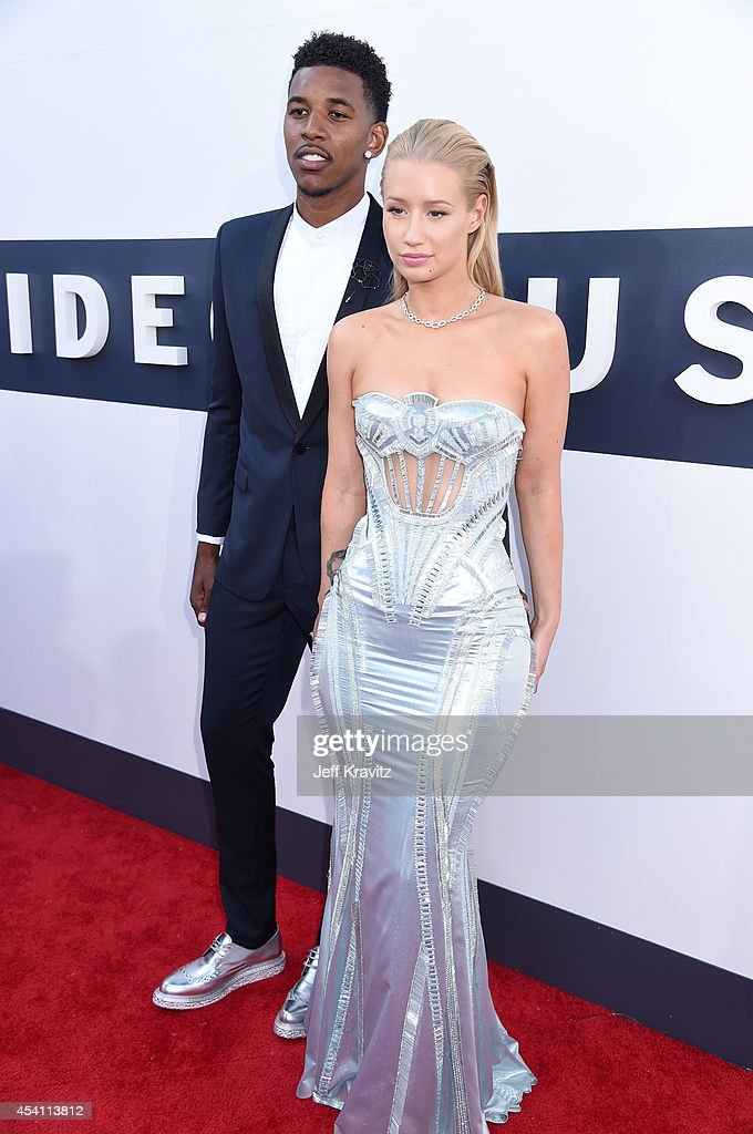 Recording artist Iggy Azalea (R) and professional athlete Nick Young attend the 2014 MTV Video Music Awards at The Forum on August 24, 2014 in Inglewood, California.