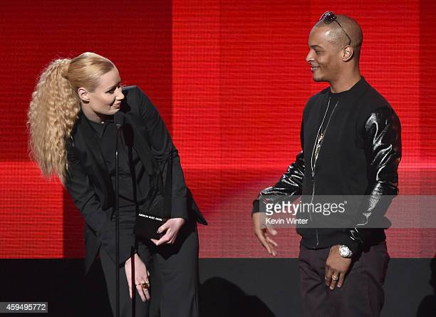 Recording artist Iggy Azalea and TI accept the Favorite Rap/HipHop Album award for 'The New Classic' onstage at the 2014 American Music Awards at...