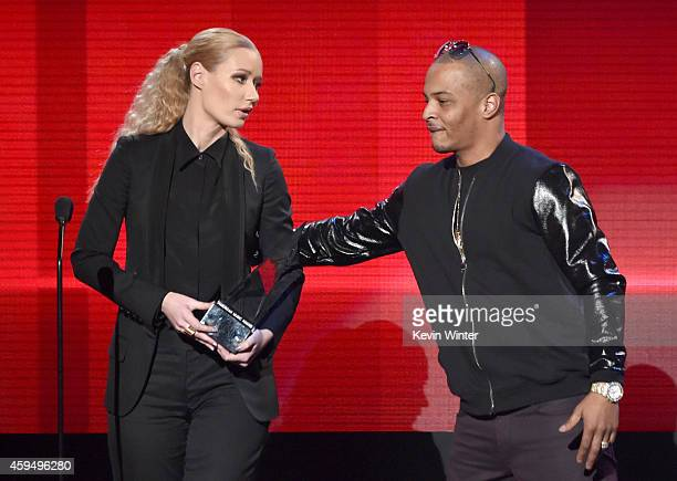 Recording artist Iggy Azalea and TI accept the Favorite Rap/HipHop Artist award onstage at the 2014 American Music Awards at Nokia Theatre LA Live on...