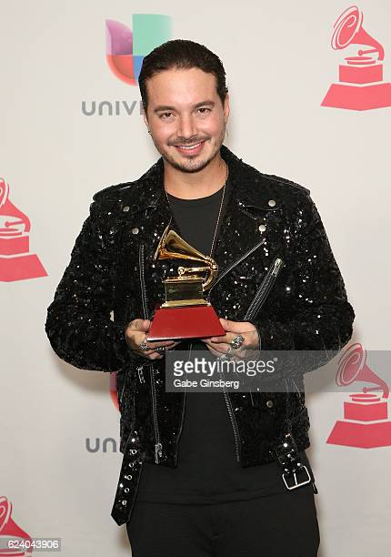 Recording artist J Balvin poses with the Best Urban Music Album award in the press room during The 17th Annual Latin Grammy Awards at TMobile Arena...