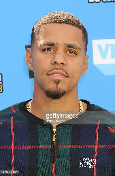 Recording artist J Cole arrives at the DoSomethingorg and VH1's 2013 Do Something Awards at Avalon on July 31 2013 in Hollywood California