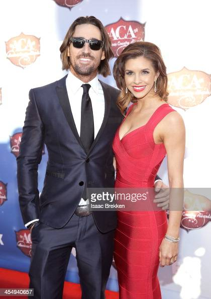 Recording artist Jake Owen and Lacey Buchanan arrive at the American Country Awards 2013 at the Mandalay Bay Events Center on December 10 2013 in Las...