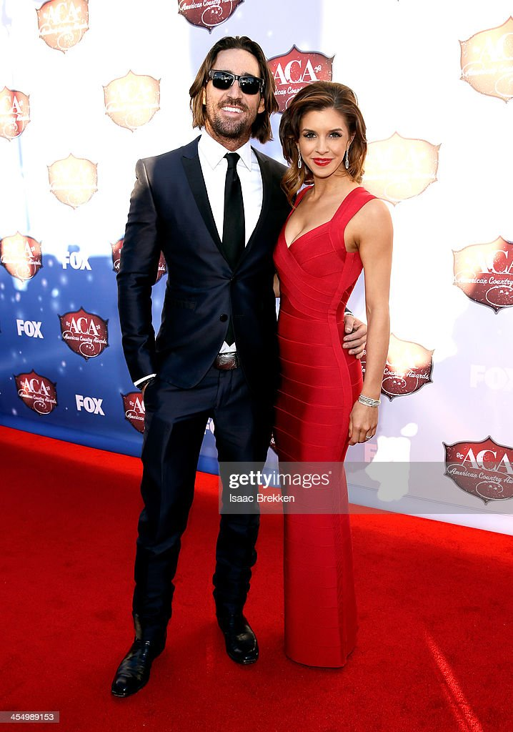 Recording artist Jake Owen (L) and Lacey Buchanan arrive at the American Country Awards 2013 at the Mandalay Bay Events Center on December 10, 2013 in Las Vegas, Nevada.