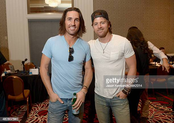 Recording artist Jake Owen and Singersongwriter Kip Moore pose backstage at the Cumulus/Westwood One Radio Remotes during the 49th Annual Academy of...