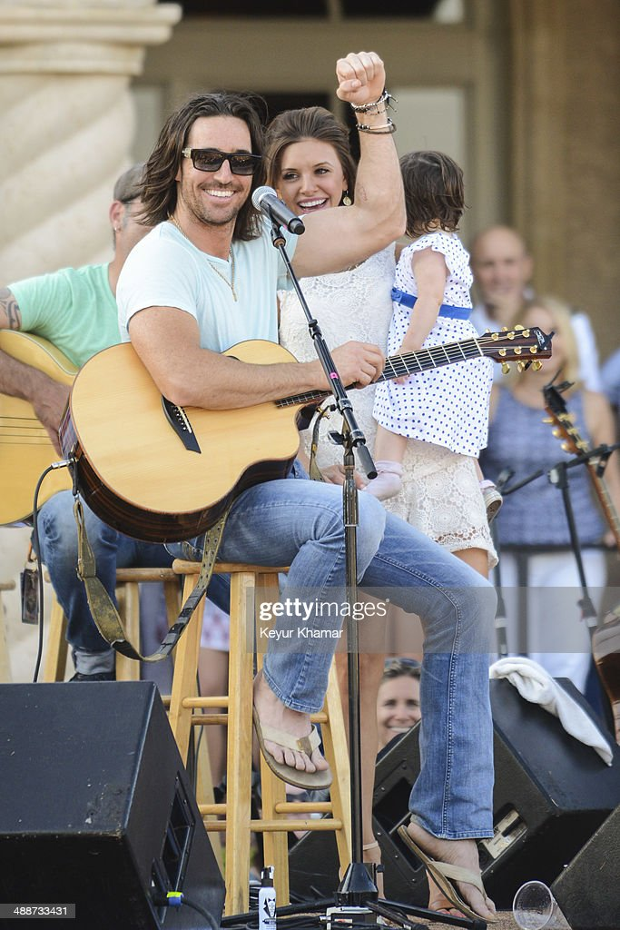 Recording artist Jake Owen introduces his wife Lacey Buchanan and their daughter Olive Pearl in concert during THE PLAYERS Championship Military Appreciation Day Ceremony outside the TPC Sawgrass clubhouse on May 7, 2014 in Ponte Vedra Beach, Florida.