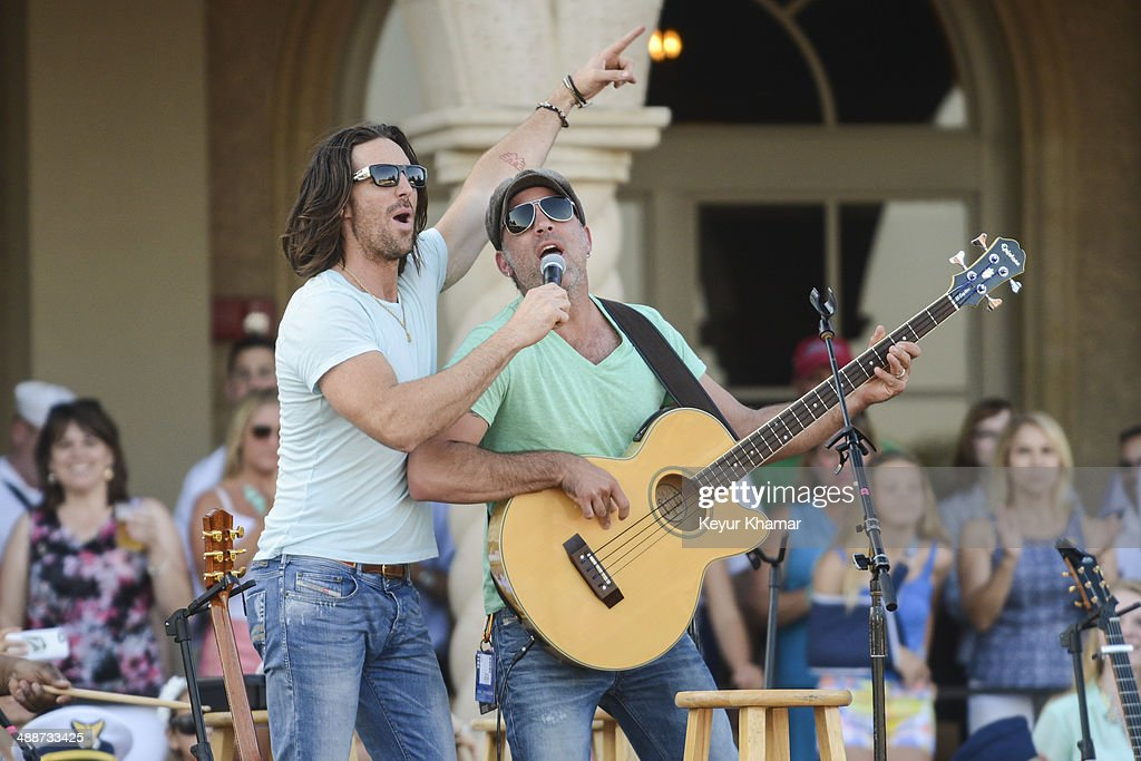 Recording artist Jake Owen performs in concert with his band during THE PLAYERS Championship Military Appreciation Day Ceremony outside the TPC Sawgrass clubhouse on May 7, 2014 in Ponte Vedra Beach, Florida.