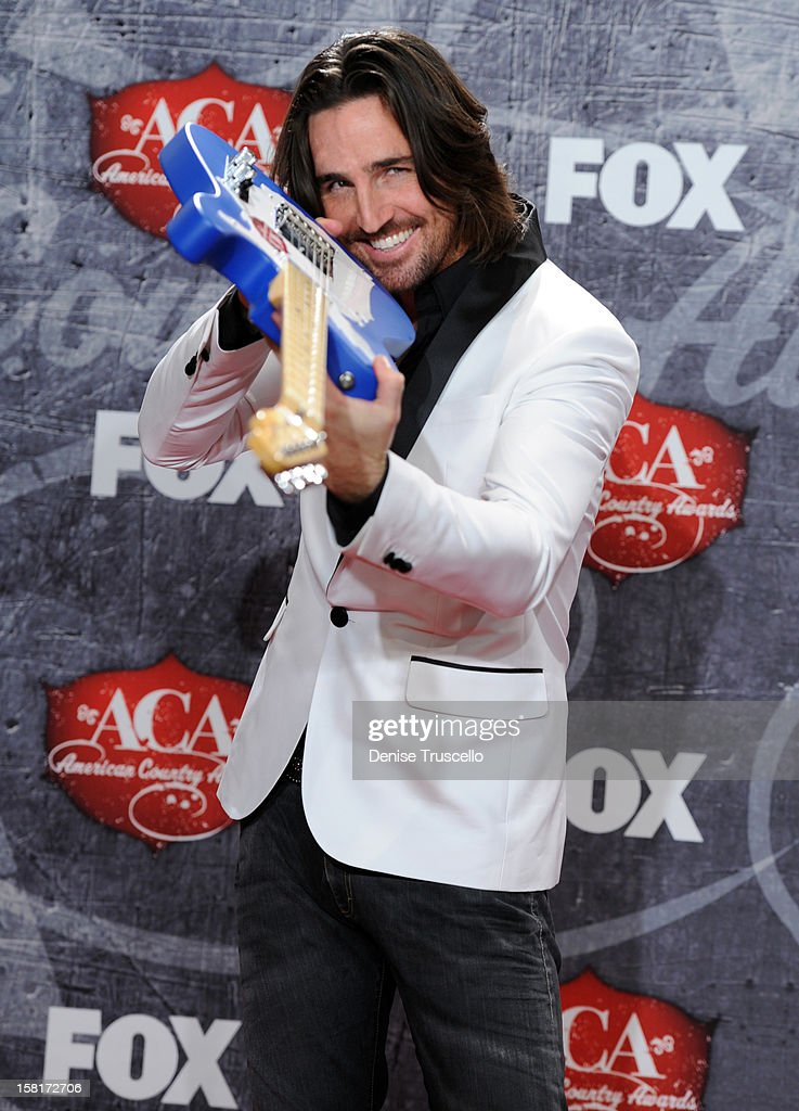 Recording artist Jake Owen poses in the press room with his award for Breakthrough Artist of the Year during the 2012 American Country Awards at the Mandalay Bay Events Center on December 10, 2012 in Las Vegas, Nevada.