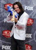 Recording artist Jake Owen poses in the press room with his award for Breakthrough Artist of the Year during the 2012 American Country Awards at the...