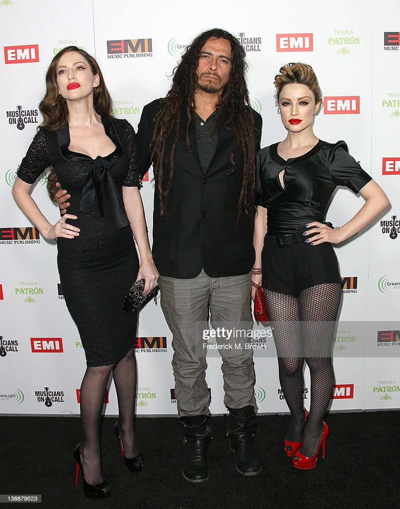 Recording artist James Monkey Shaffer (C) and his guest attend the EMI GRAMMY After Party at the Capital Records Building on February 12, 2012 in Hollywood, California.