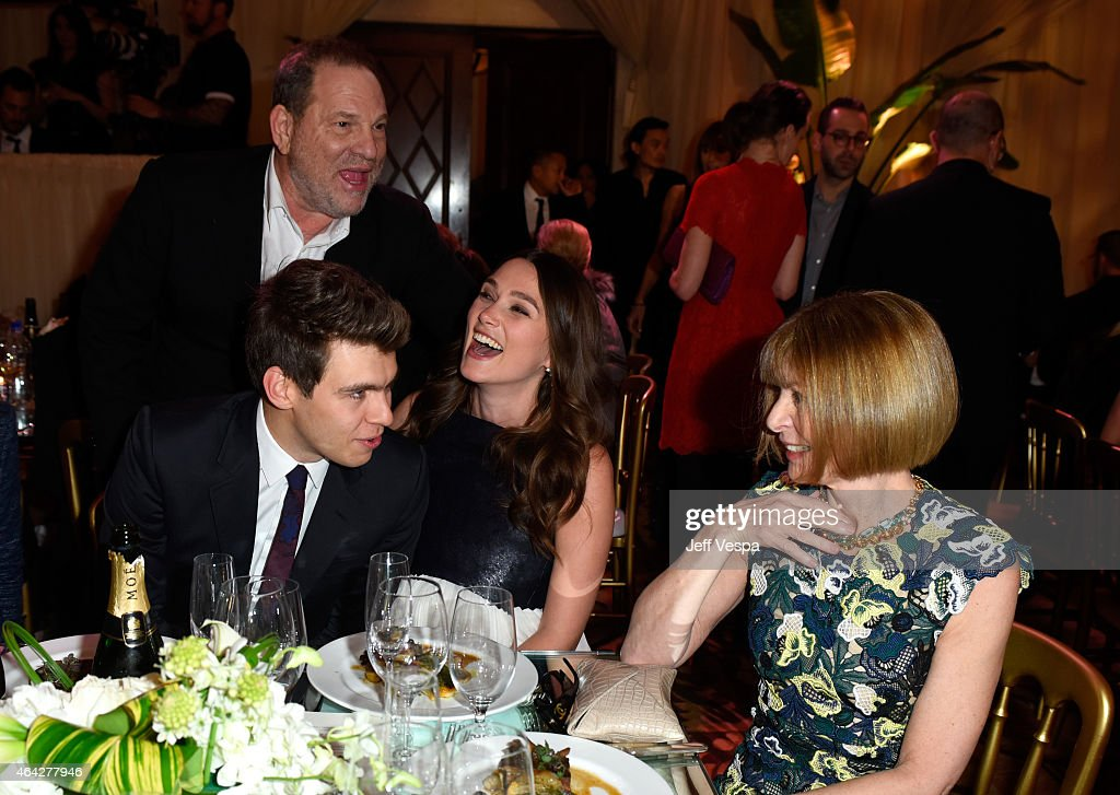 Recording artist James Righton, Co-Chairman of The Weinstein Company Harvey Weinstein (standing), actress Keira Knightley, and Editor-in-Chief of 'Vogue' magazine Anna Wintour attend The Weinstein Company's Academy Awards Nominees Dinner in partnership with Chopard, DeLeon Tequila, FIJI Water and MAC Cosmetics on February 21, 2015 in Los Angeles, California.