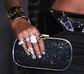 Recording Artist Janelle Monae jewelry and purse detail attends the Premiere of Walt Disney Pictures and Lucasfilm's 'Star Wars The Force Awakens' on...