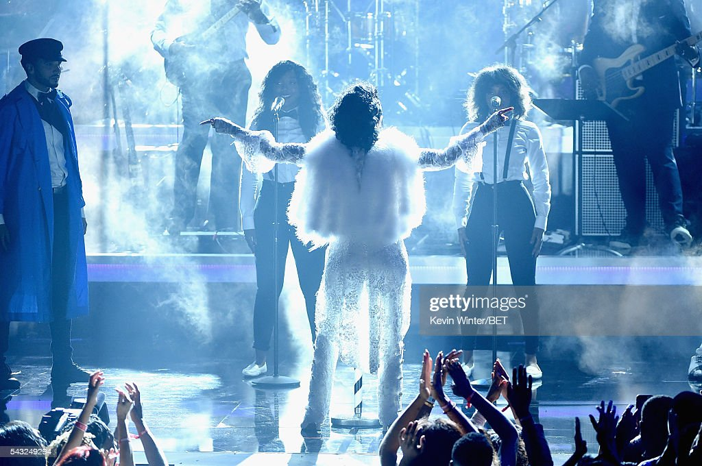 Recording artist <a gi-track='captionPersonalityLinkClicked' href=/galleries/search?phrase=Janelle+Monae&family=editorial&specificpeople=715847 ng-click='$event.stopPropagation()'>Janelle Monae</a> (C) performs onstage during the 2016 BET Awards at the Microsoft Theater on June 26, 2016 in Los Angeles, California.