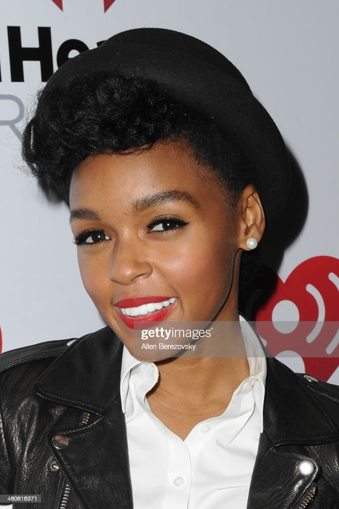 Recording artist Janelle Monae poses for pictures after performing during the Clear Channel's iHeartRadio Live Series Concert at iHeartRadio Theater on March 25, 2014 in Burbank, California.