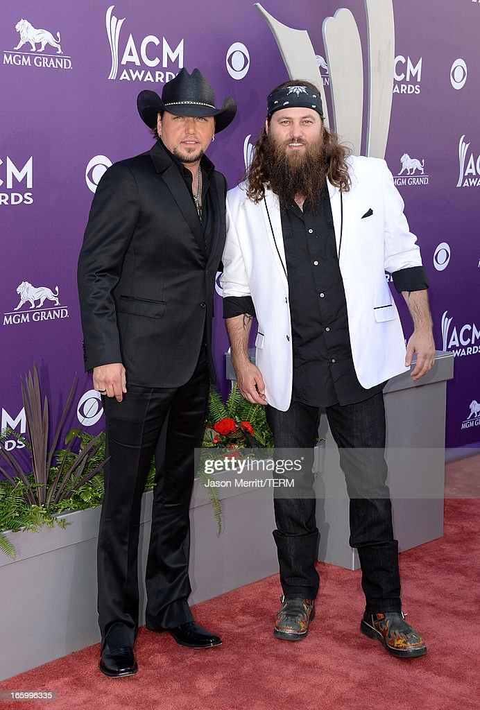 Recording artist Jason Aldean (L) and television personality Willie Robertson arrive at the 48th Annual Academy of Country Music Awards at the MGM Grand Garden Arena on April 7, 2013 in Las Vegas, Nevada.