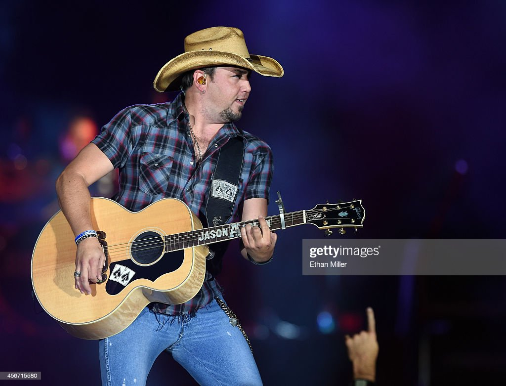 Recording artist <a gi-track='captionPersonalityLinkClicked' href=/galleries/search?phrase=Jason+Aldean&family=editorial&specificpeople=619221 ng-click='$event.stopPropagation()'>Jason Aldean</a> performs during the Route 91 Harvest country music festival at the MGM Resorts Village on October 5, 2014 in Las Vegas, Nevada.