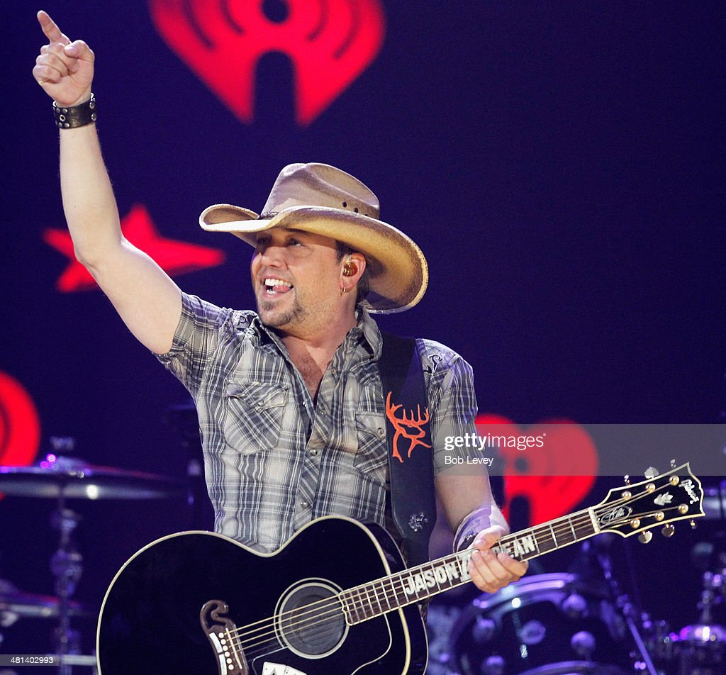 Recording artist Jason Aldean performs onstage during iHeartRadio Country Festival in Austin at the Frank Erwin Center on March 29, 2014 in Austin, Texas.
