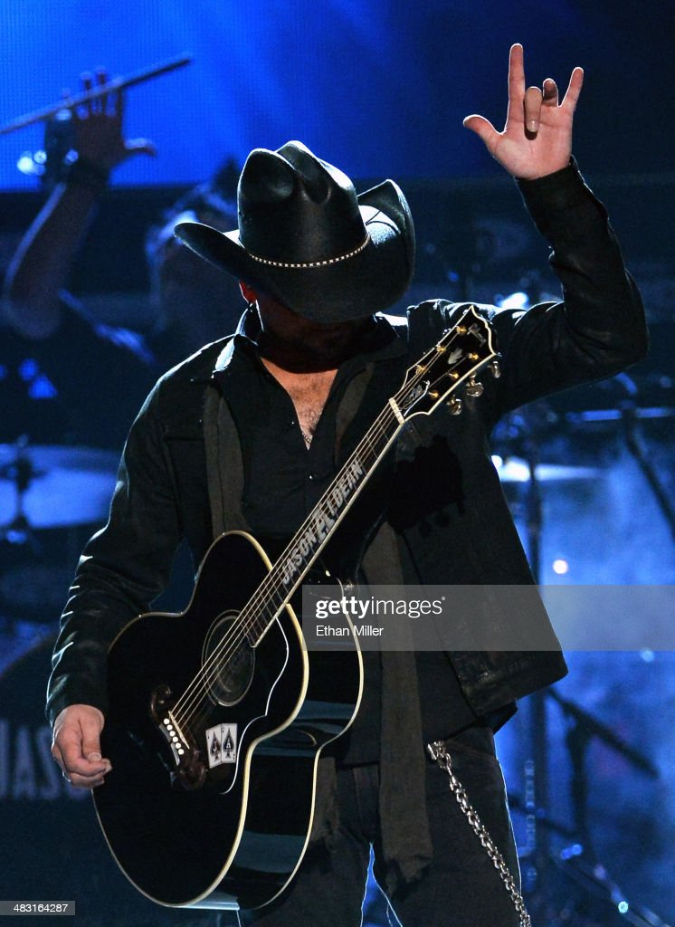 Recording artist <a gi-track='captionPersonalityLinkClicked' href=/galleries/search?phrase=Jason+Aldean&family=editorial&specificpeople=619221 ng-click='$event.stopPropagation()'>Jason Aldean</a> performs onstage during the 49th Annual Academy of Country Music Awards at the MGM Grand Garden Arena on April 6, 2014 in Las Vegas, Nevada.