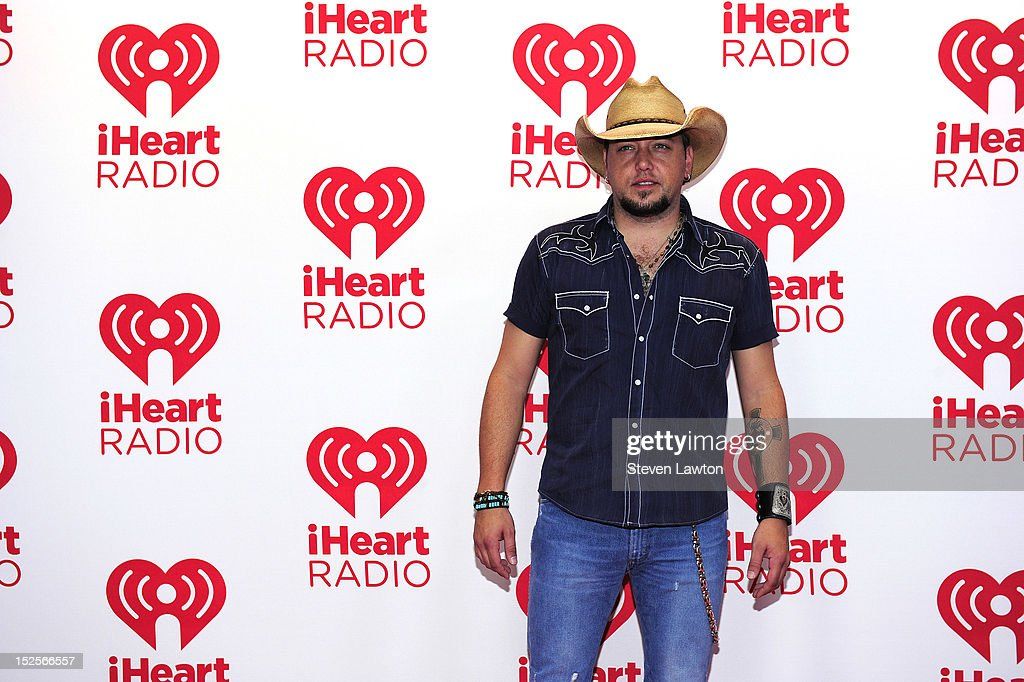 Recording artist <a gi-track='captionPersonalityLinkClicked' href=/galleries/search?phrase=Jason+Aldean&family=editorial&specificpeople=619221 ng-click='$event.stopPropagation()'>Jason Aldean</a> poses in the press room at the iHeartRadio Music Festival at the MGM Grand Garden Arena September 21, 2012 in Las Vegas, Nevada.