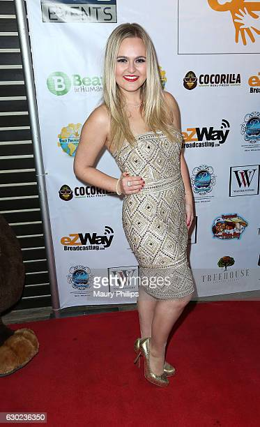 Recording artist Jayme Claire arrives at eZWayCares Community Santa Toy Drive on December 18 2016 in Los Angeles California