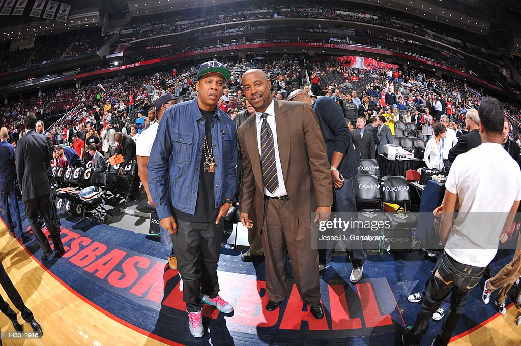 Recording artist Jay-Z, left, poses with former New Jersey Nets player Kenny Anderson before a game between the Philadelphia 76ers and New Jersey Nets on April 23, 2012 at the Prudential Center in Newark, New Jersey.