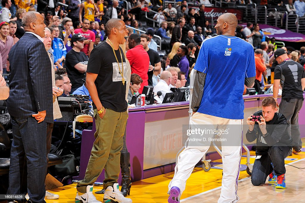 Recording artist Jay-Z speaks with Kobe Bryant #24 of the Los Angeles Lakers during a break in game against the Oklahoma City Thunder at Staples Center on January 27, 2013 in Los Angeles, California.