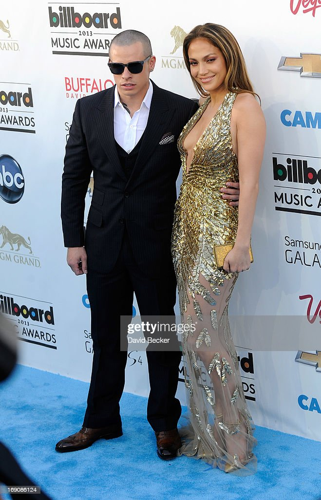 Recording Artist Jennifer Lopez (R) and Casper Smart arrive at the 2013 Billboard Music Awards at the MGM Grand Garden Arena on May 19, 2013 in Las Vegas, Nevada.